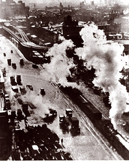 early photo of train and vehicular traffic on Delaware Avenue